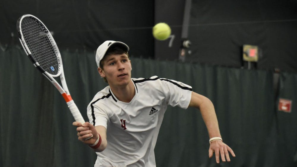 Then-sophomore Bennett Crane reaches for a forehand during his 6-2, 6-7, 4-6 singles loss against Wisconsin last season at the IU Tennis Center. IU men's tennis will take on Drake University and Utah State University this weekend in Des Moines, Iowa.