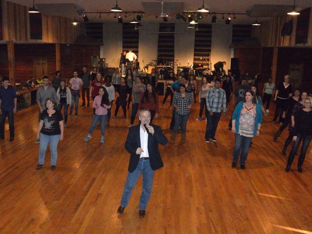 Instructor Billy Crase teaches line dancing lessons April 10, 2016, at  Mike's Dance Barn located in Nashville, Indiana.