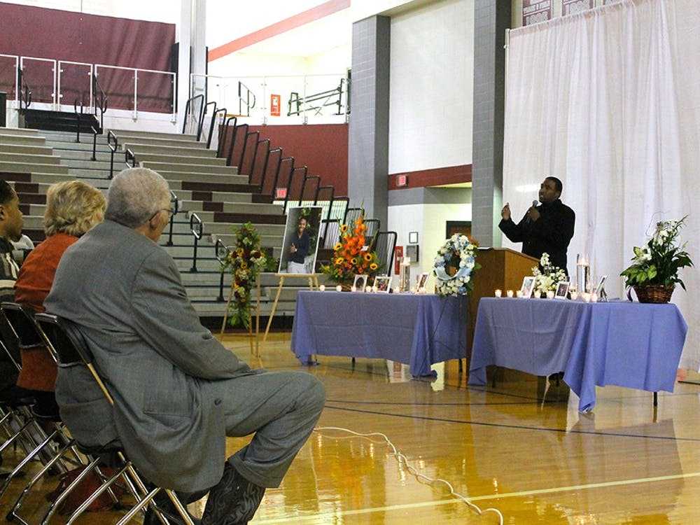 The Rev. Anthony Brown speaks at a memorial service for IU student Joseph Smedley on Saturday at Lawrence Central High School. Smedley's body was found Oct. 2 in Griffy Lake after the student was reported missing Sept. 28.