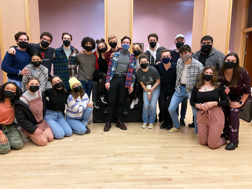 """The """"Into the Woods"""" cast and team pose for a picture before their closingnight performance Saturday. There were three performances of the show with each audience limited to 18 people."""