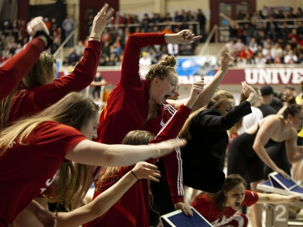 The IU women's swimming team cheers on a teammate Feb. 23, 2020, in the Counsilman-Billingsley Aquatics Center. Both the men's and women's swimming and diving teams beat Purdue and Rutgers on Saturday in West Lafayette, Indiana.