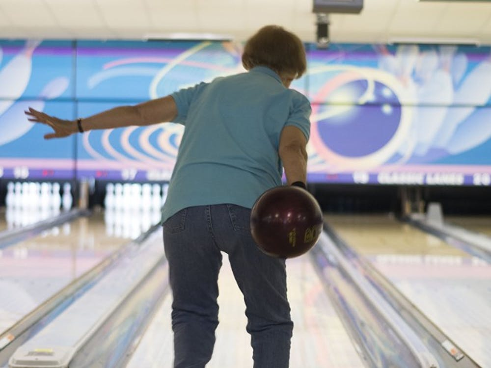 Linda H. picks up a spare at the weekly ladies bowling league at Classic Lanes.