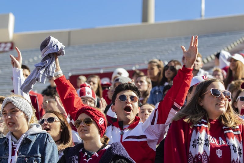 An IU football fan cheers before the game Oct. 12 in Memorial Stadium. Students received free Homecoming shirts before the game began.