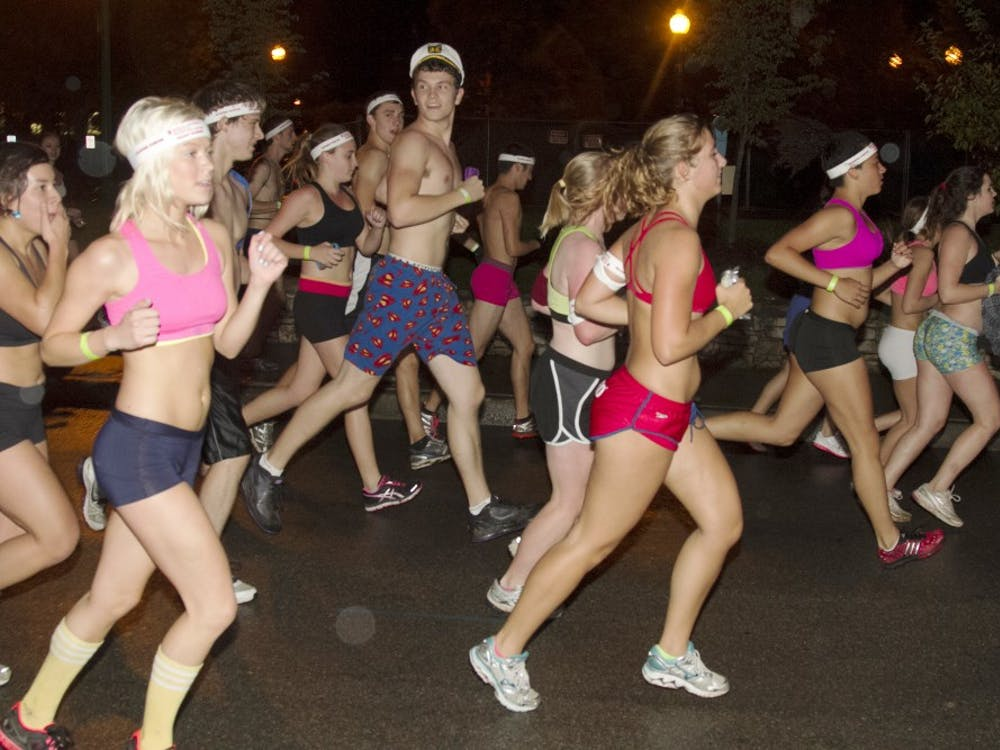 Participants in last year's Nearly Naked Mile run through the IU Bloomington campus on Oct. 1, 2012.