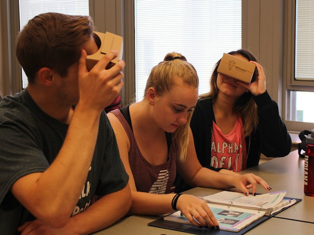 Freshman Kurt Simpson, sophomore Kelsey Harper and freshman Skyler Blanton use the Google Cardboard Viewers to see 360 degree images of Spanish countries. Lecturer Olga Scrivner incorporates virtual reality into her beginning Spanish course.