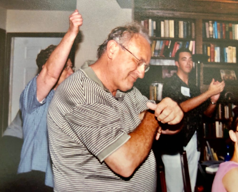 <p>Carl Ziegler dances at his house with Mark Helmsing and other students after a back-to-school student dinner in August 2003. Ziegler, 80, died on April 19.</p>