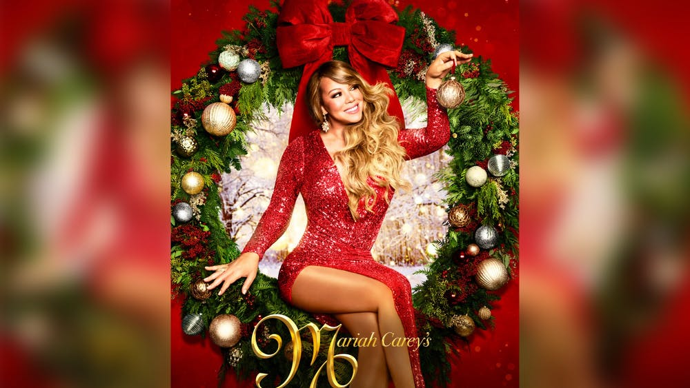 """Mariah Carey's Magical Christmas Special"" flyer is pictured."