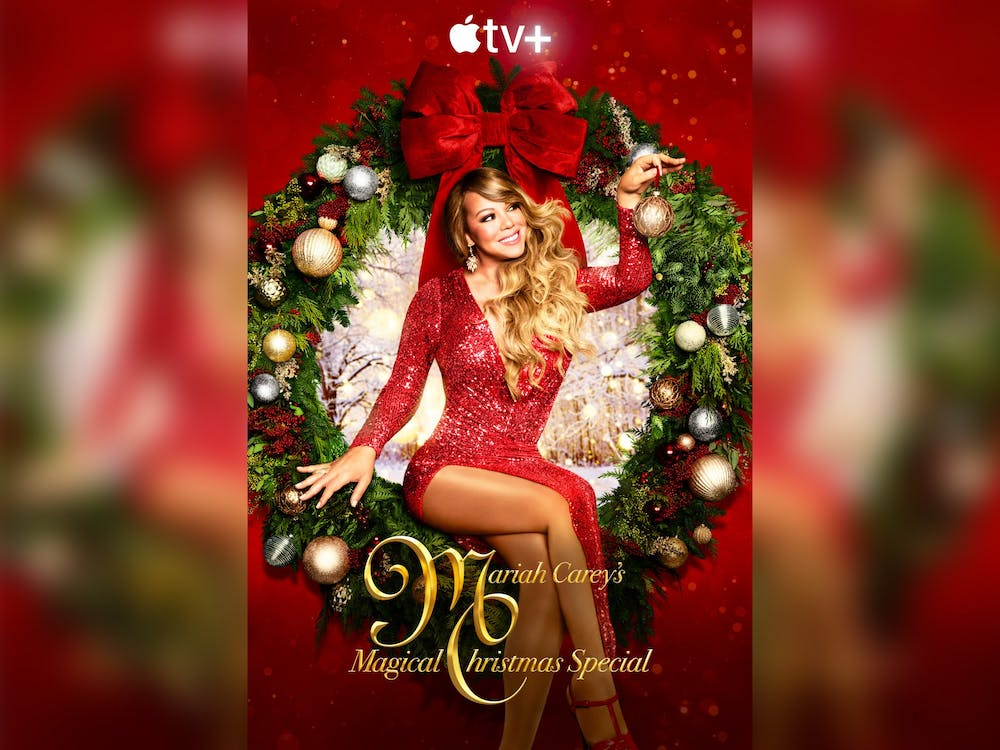 """""""Mariah Carey's Magical Christmas Special"""" flyer is pictured."""