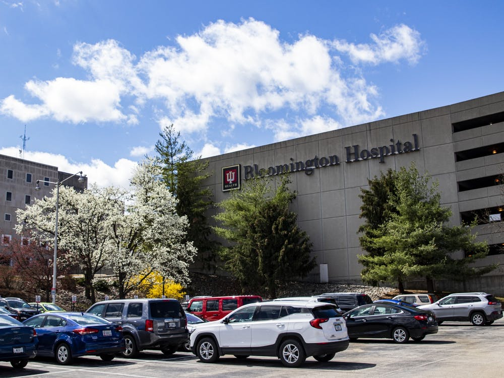 Cars sit parked in the patient parking lot March 29 at IU Health Bloomington Hospital. IU Health hospitals will reopen for surgery May 4.