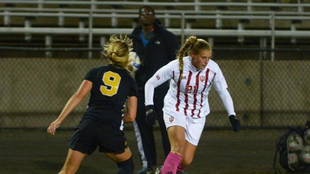 Red-shirt junior midfielder Kayleigh Steigerwalt dribbles around a player during the game against Iowa Saturday evening at Bill Armstrong Stadium. The Hoosiers and the Hawkeyes tied 0-0.