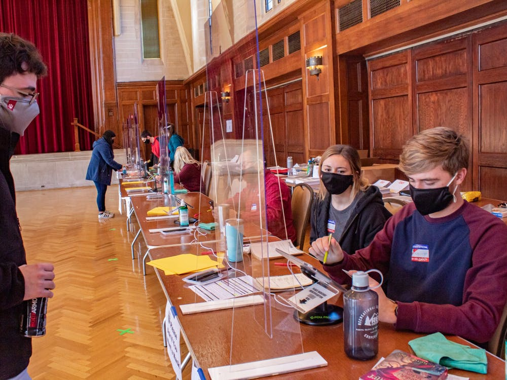 Riley Knight helps a voter get checked in to vote on Election Day at the Indiana Memorial Union. Knight also worked the polls in 2018.