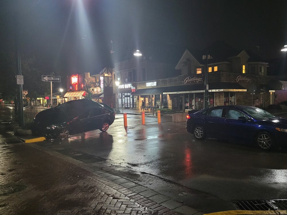 Cars sit in the street after being damaged by flood waters Friday night on Kirkwood Ave. Bloomington residents can schedule pickup of items related to flooding last weekend from the Sanitation Division of the City of Bloomington's Public Works Department.