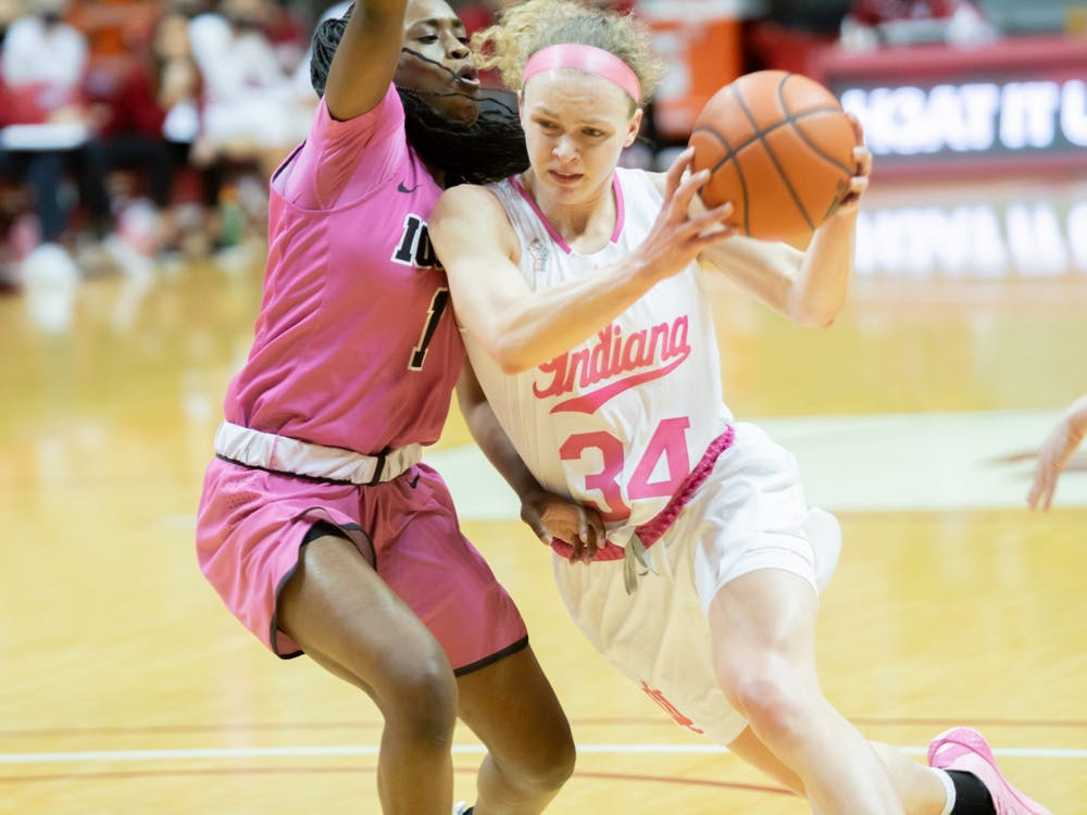 Junior guard Grace Berger drives against the Iowa defense Wednesday at Simon Skjodt Assembly Hall. The Hoosiers were down 38-43 to the Hawkeyes at halftime.