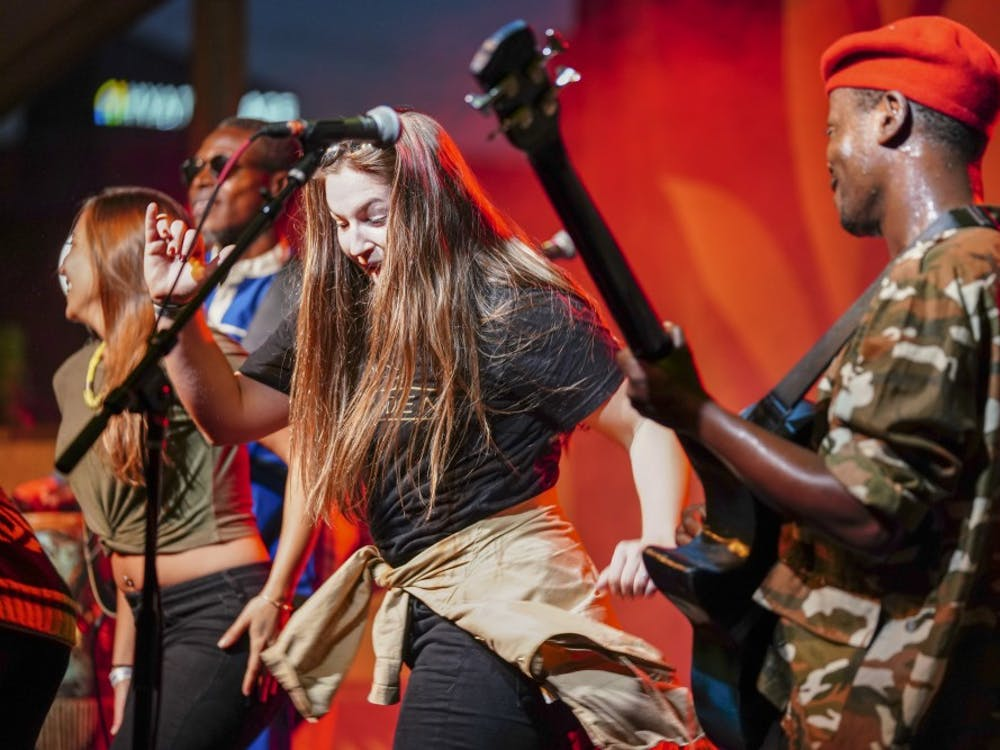 Jupiter & Okwess invite women up on stage to dance with them during the 2018 Lotus World Music & Arts Festival on Sept. 29 in the Alchemy/Old National Bank Tent. Jupiter & Okwess performed high-energy Congolese soukous.