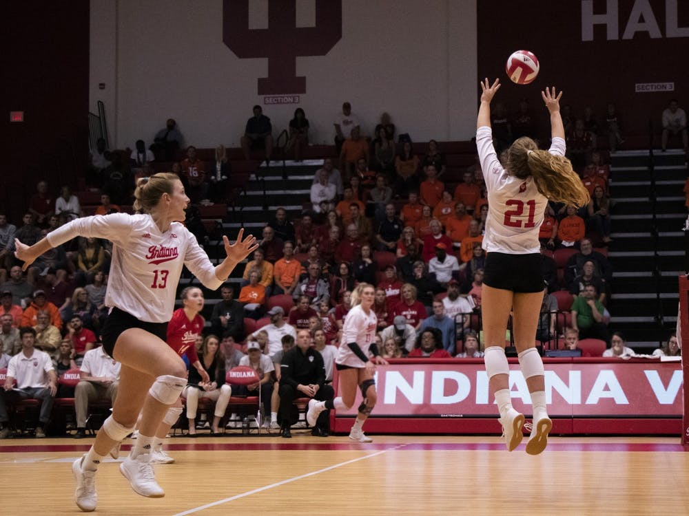 Then-freshman Emily Fitzner sets up then-senior Jacqui Armer against Illinois Oct. 4, 2019, at Wilkinson Hall. IU opens its season Friday against Nebraska.