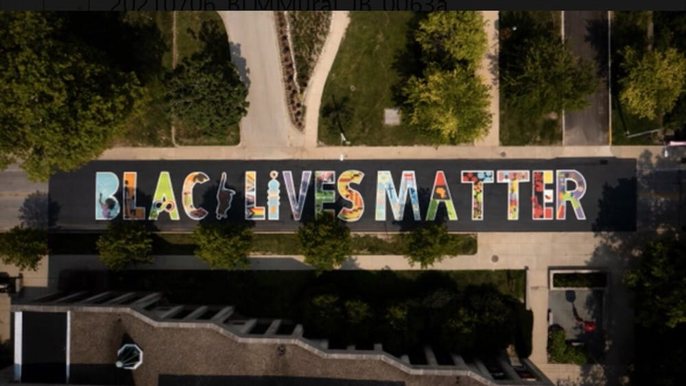 A Black Lives Matter mural created by IU students located on Jordan Avenue. Each letter of the new Black Lives Matter mural has something every person can relate to, Tiera Howleit said.