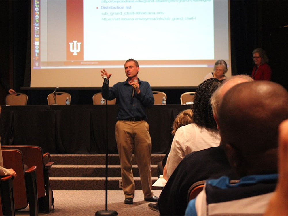 Rick Van Kooten, interim vice provost for research, lays out the plans for IU's Grand Challenges selection process at the open town hall meeting in Whittenberger Auditorium Monday. IU will choose five Grand Challenges proposed by faculty members to strive for in the next five years.