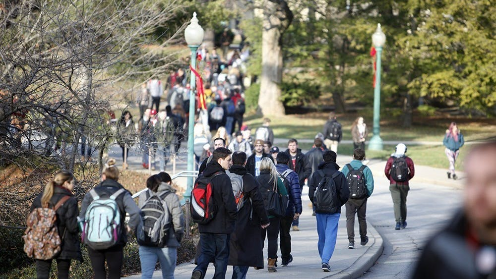 IU students walk on campus in between classes. IU President Michael McRobbie announced Feb. 24 that the fall semester would return to mostly normal operations, including in-person instruction for most classes.