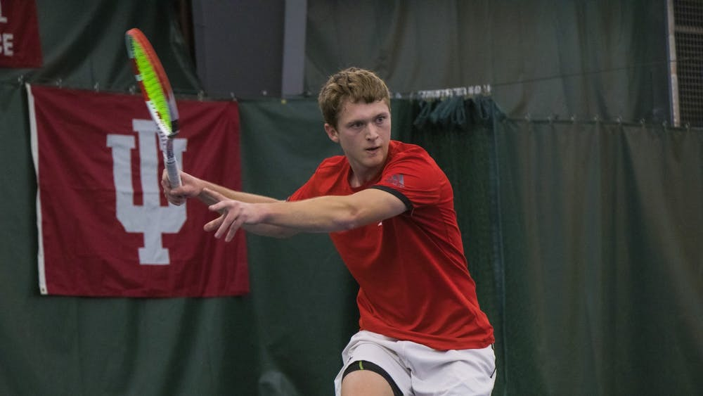 Sophomore Carson Haskins watches the ball against the University of Notre Dame on Feb. 1 at the IU Tennis Center. IU defeated Notre Dame 4-3.
