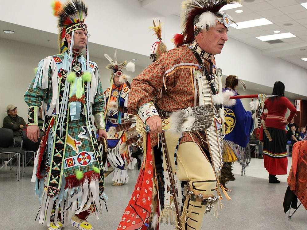 David Higgins and other members of First Nations perform in the inter-tribal dance at the Native American Health and Wellness Community Dance Saturday at the Union Street Center Auditorium.
