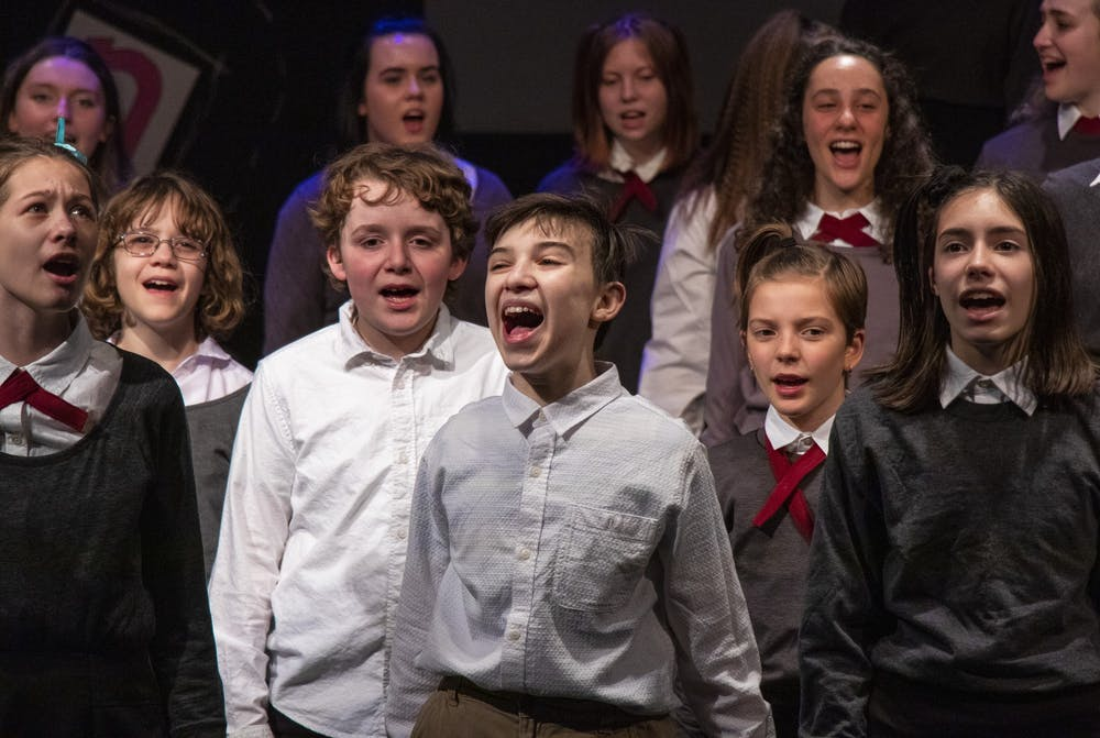 """<p>The """"Matilda the Musical"""" cast rehearses the song """"When I Grow Up"""" on March 2 at Whikehart Auditorium in the John Waldron Arts Center. Arts Forward Bloomington sent a letter to city officials in support of the center. </p>"""