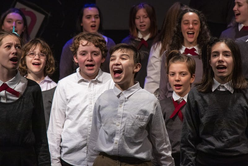 "The ""Matilda the Musical"" cast rehearses the song ""When I Grow Up"" on March 2 at Whikehart Auditorium in the John Waldron Arts Center. Arts Forward Bloomington sent a letter to city officials in support of the center."