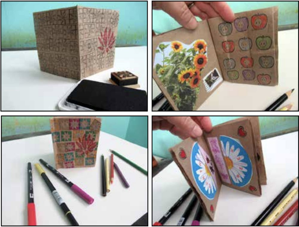 <p>Lotus Blossoms participant LuAnne Holladay creates a Lotus Blossoms bag book craft for the event.<strong> </strong>The Lotus Education &amp; Arts Foundation will put on its annual Lotus Blossoms event from 11 a.m. to 3 p.m. April 10.</p>