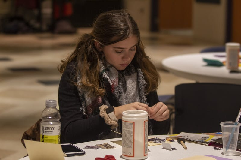 Freshman Elizabeth Algeri makes a craft Jan. 23 in the Willkie Auditorium. The Art of Resistance: Past and Present honored Martin Luther King Jr. and the history of black resistance.