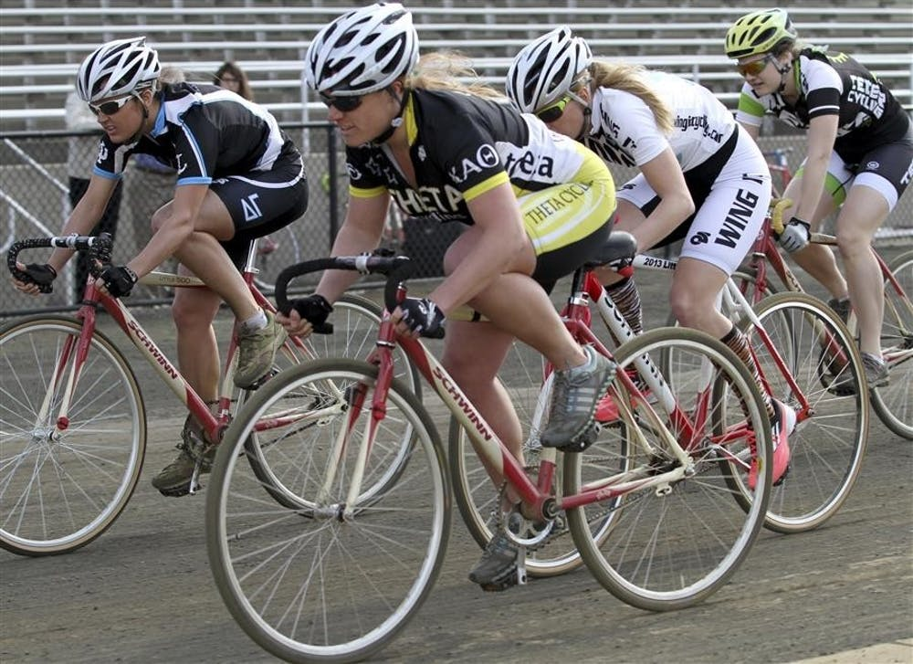 <p>Miss-N-Out winner Kayce Doogs of Delta Gamma competes with Kathleen Chelminiak of Kappa Alpha Theta and Teter rider Lisa Hutcheson in their last lap around the track during the Little 500 Miss-N-Out on April 6, 2013, at Bill Armstrong Stadium.</p>