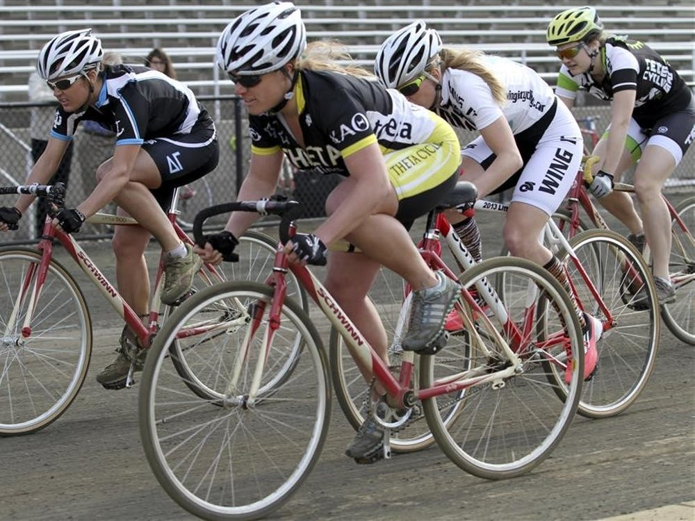 Miss-N-Out winner Kayce Doogs of Delta Gamma competes with Kathleen Chelminiak of Kappa Alpha Theta and Teter rider Lisa Hutcheson in their last lap around the track during the Little 500 Miss-N-Out on April 6, 2013, at Bill Armstrong Stadium.