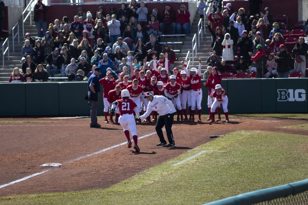 <p>Then-freshman Juvia Davis is greeted March 17, 2019, by her teammates at home plate after hitting a grand slam for the Hoosiers at Andy Mohr Field. The Hoosiers lost to the Iowa Hawkeyes 2-1 in the 10th inning Sunday.</p>