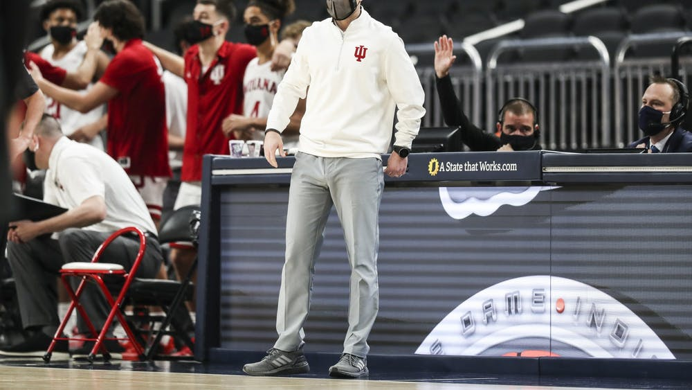 IU men's basketball head coach Archie Miller watches from the sideline Dec. 19 at Bankers Life Fieldhouse in Indianapolis. IU defeated Butler University 68-60 in the Crossroads Classic.