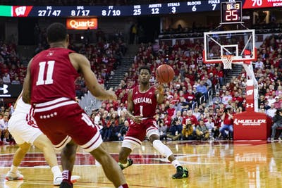 Junior guard Aljami Durham passes the ball to senior guard Devonte Green Dec. 7 at the Kohl Center in Madison, Wisconsin. Durham and Green are IU's team captains for the 2019-20 men's basketball season.