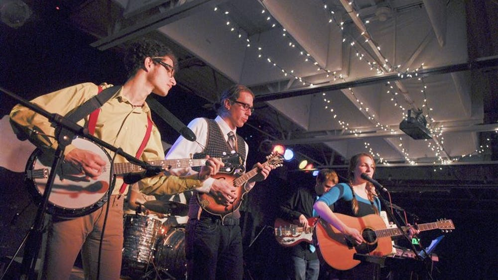 Local band Best Friends performs during Chocolate Prom  on Friday at Rhino's.