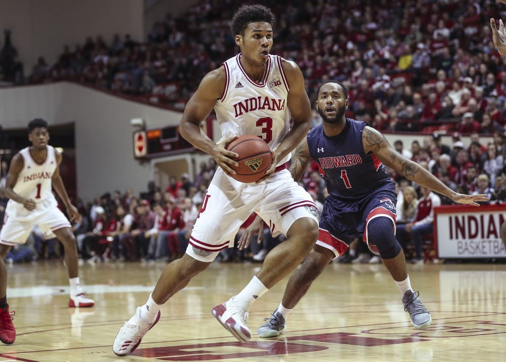 <p>Freshman forward Justin Smith dribbles to the basket during Indiana's game against Howard University on Sunday. The Hoosiers beat Howard 86-77.&nbsp;</p>