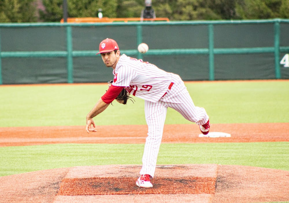 <p>Junior pitcher Tommy Sommer pitches in the first game of a doubleheader against Minnesota on Friday at Bart Kaufman Field. The IU baseball team swept Minnesota in a three-game series this weekend.</p>