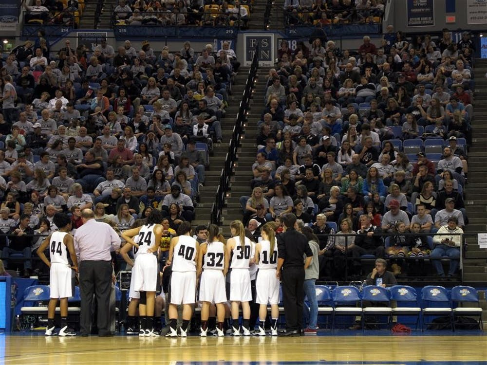The Western High School Panthers huddle up during a timeout in the IHSAA 3A girls basketball state finals. Western would win against two-time champions Evansville Mater Dei, 38-35.