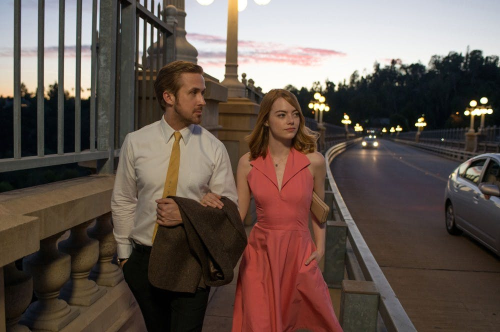 "Ryan Gosling as Sebastian and Emma Stone as Mia in a scene from the movie ""La La Land"" directed by Damien Chazelle. (Dale Robinette/Lionsgate)"