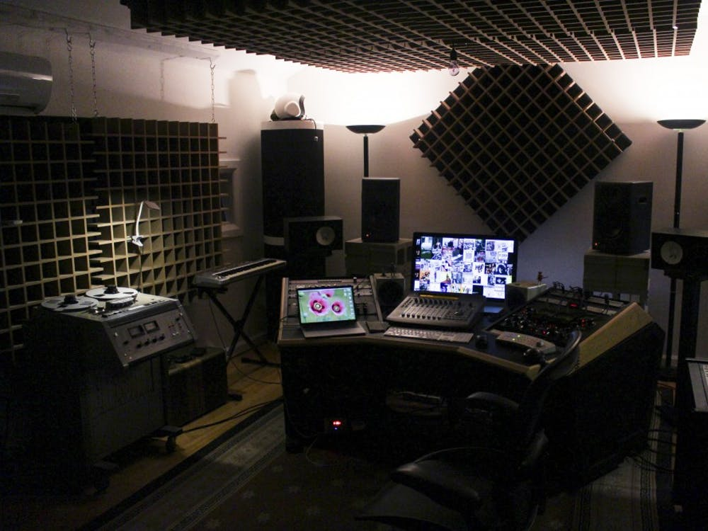 Inside Paul Mahern's home recording studio, each piece of recording equipment is precisely placed to ensure optimal sound.