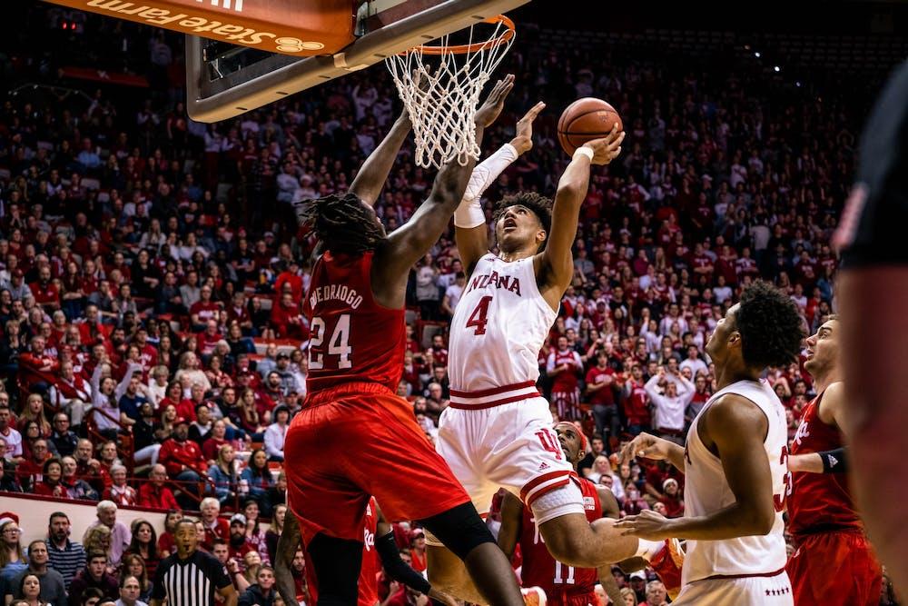 <p>Freshman Trayce Jackson-Davis jumps to score against Nebraska freshman Yvan Ouedraogo on Dec. 13 in Simon Skjodt Assembly Hall. Jackson-Davis scored a total of 25 points.</p>