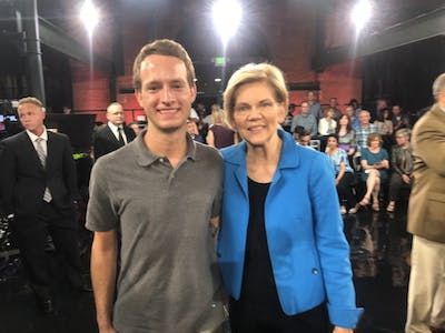 Columnist James Bassett poses for a photo with Democratic presidential candidate Elizabeth Warren. Bassett says that the gesture of taking photos with people does a lot for a politician's campaign.