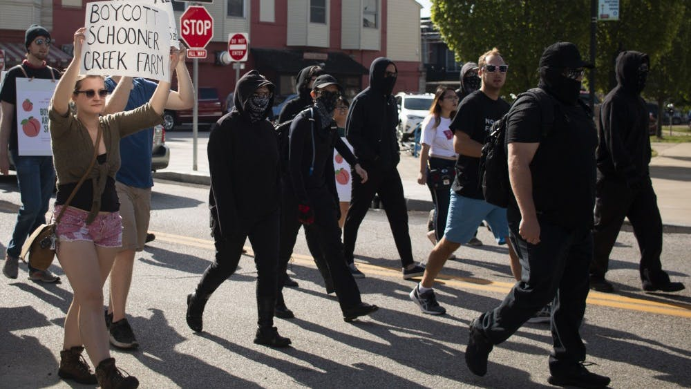 Members of the Bloomington community, antifa, and No Space for Hate march toward the Bloomington Community Farmers' Market on Aug. 24 to protest the continued presence of the vendor Schooner Creek Farm. The market has been under scrutiny as of late, due to the continued presence of Schooner Creek Farm, which is run by people with alleged ties to white nationalism.