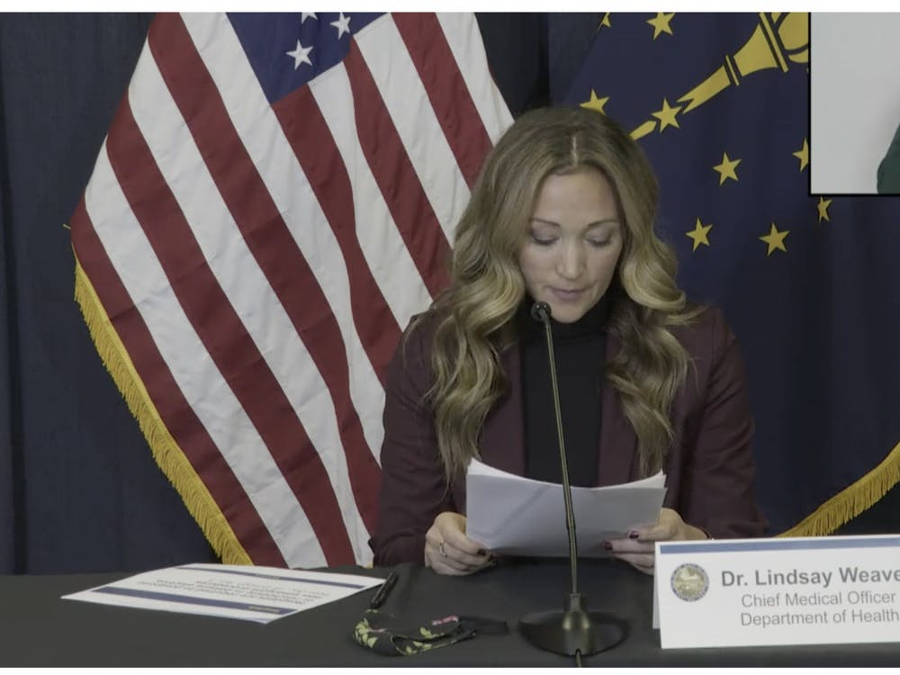 Dr. Linsday Weaver, chief medical officer for the Indiana State Department of Health, speaks Wednesday during Gov. Holcomb's COVID-19 press conference. Indiana will receive its first supply of the Pfizer vaccine next week and will start administering it to health care workers.