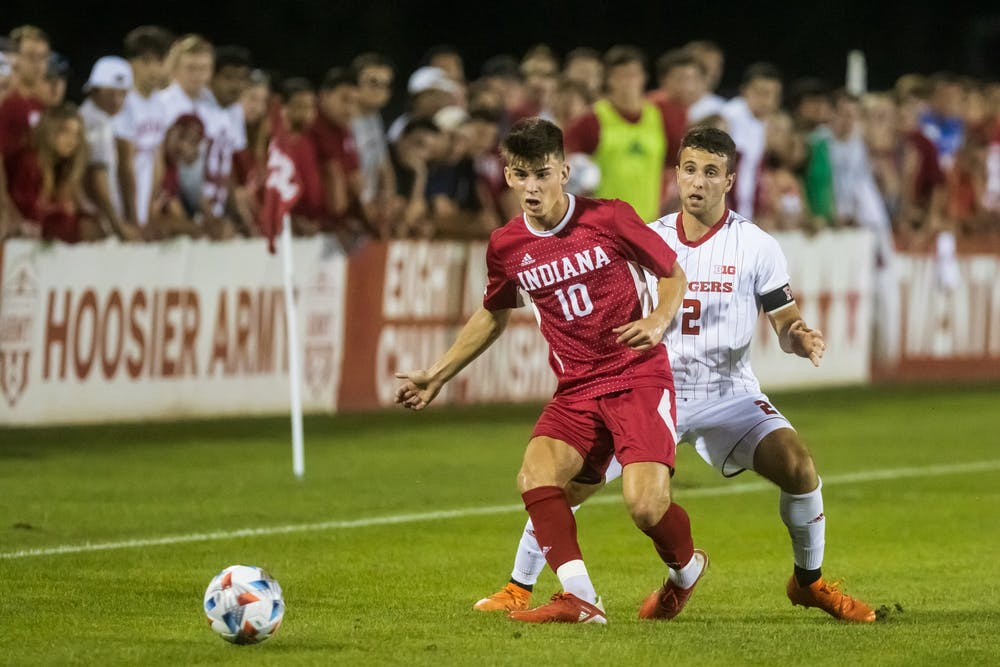 <p>Freshman forward Tommy Mihalic passes the ball to a teammate  Sept. 17, 2021 at Bill Armstrong Stadium. Mihalic scored one of Indiana&#x27;s nine goals Saturday. </p>