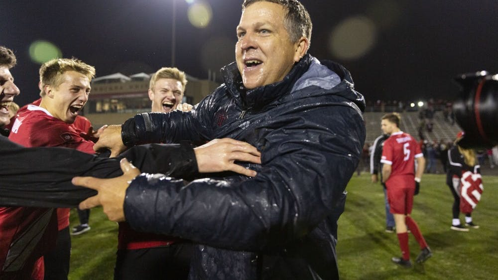 Coach Todd Yeagley celebrates with the team after the NCAA Tournament quarterfinal against Notre Dame on Nov. 30 at Bill Armstrong Stadium. The team found Yeagley in the crowd after the game and dumped water on him to celebrate.
