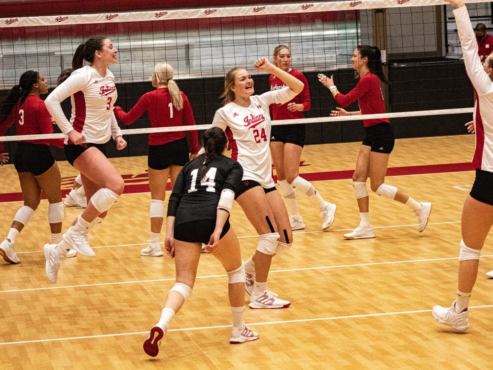 The Hoosiers celebrate a point in the first set against Nebraska on Jan. 22 in Wilkinson Hall. IU lost in three sets, 22-25, 20-25 and 17-25.