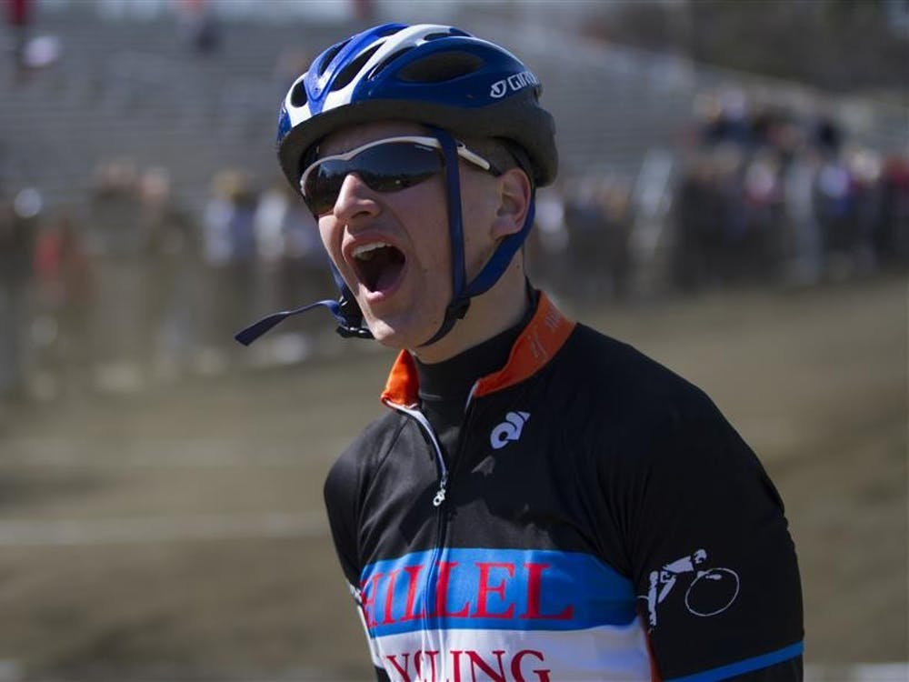 Senior captain Jeremy Levin of Hillel Cycling cheers on his teamatesduring Qualifications on March 22 at Bill Armstrong Stadium.