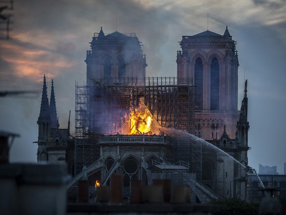 Smoke and flames rise from Notre Dame Cathedral on April 15 in Paris. A fire broke out last Monday afternoon and quickly spread across the building, collapsing the spire.