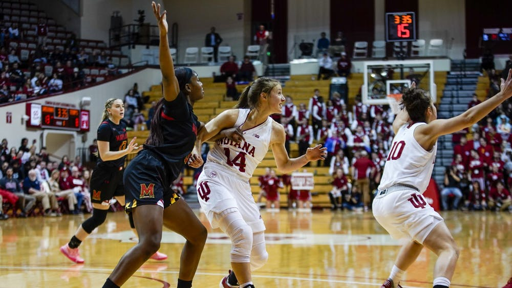 Red shirt junior Ali Patberg fights to defend senior Kaila Charles on Feb. 6 in Simon Skjodt Assembly Hall.  Patberg was the leading scorer for the night with 16 points. Correction: A previous version of this caption misspelled Ali Patberg's name. The IDS regrets this error.