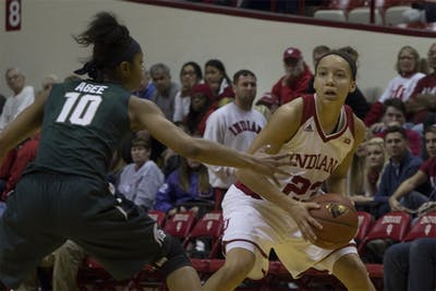 Junior guard Alexis Gassion looks to move around a Michigan State player on Wednesday night at Assembly Hall. The Hoosiers won the game 85-61.